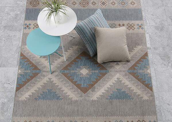 Outdoor rugs, scatter cushions and side tables